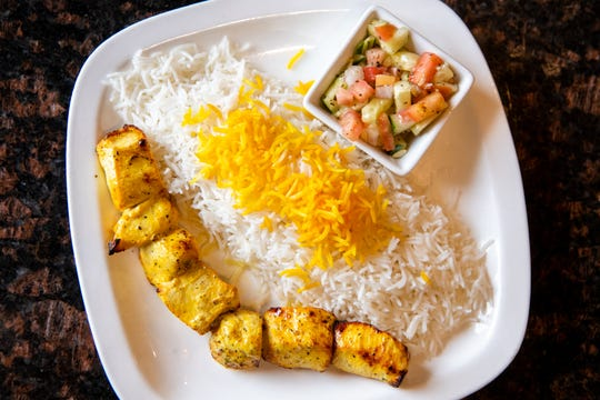 The junior chicken kabab is served with skewered chicken, white rice and shirazi salad at House of Kabob Wednesday, June 5, 2019, in Nashville, Tenn.