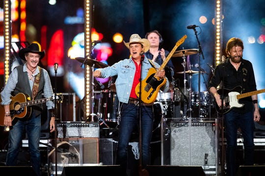 """Brooks & Dunn perform with Jon Pardi, center, during a taping of """"CMT Crossroads"""" on a stage built on Broadway on Tuesday, June 4, 2019."""