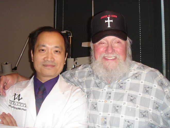 Mr. Charlie Daniels, Tennessee's first 3D laser-assisted cataract surgery patient, and Dr. Ming Wang, director of Wang Vision 3D Cataract & LASIK Center.
