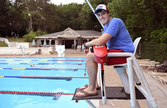 Nashville 8th-grade math teacher Kevin Stevens works as a lifeguard at West Meade Swim & Tennis Club on Wednesday, June 5, 2019.