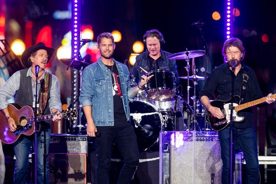 Brooks & Dunn perform with Brett Young during CMT Crossroads on a stage built on Broadway Tuesday, June 4, 2019, in Nashville, Tenn.