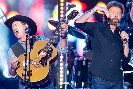 Brooks & Dunn perform during CMT Crossroads on a stage built on Broadway Tuesday, June 4, 2019, in Nashville, Tenn.