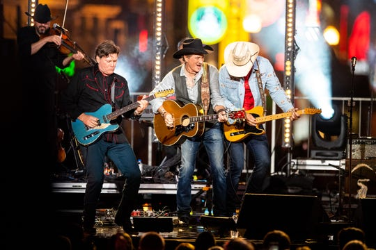 Kix Brooks of Brooks & Dunn performs with Jon Pardi during CMT Crossroads on a stage built on Broadway Tuesday, June 4, 2019, in Nashville, Tenn.