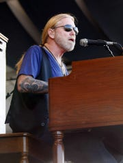 Greg Allman performs with the Allman Brothers band at the New Orleans Jazz and Heritage Festival in New Orleans, Sunday, April 25, 2010. (AP Photo/Gerald Herbert)