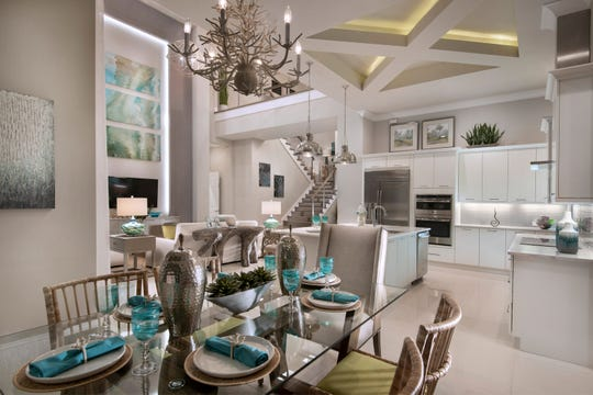 The Wyndam model priced at $2,399,990 fully furnished showcases an interior design by Vogue Interiors.