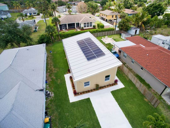 Aerial view of solar panels on an East Naples home developed by local businessman Jim Henderson.