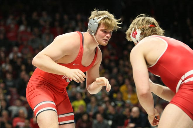 Ohio State's Chase Singletary sizes up his opponent during a match at the Big Ten championships March 9, 2019, in Minneapolis, Minnesota.