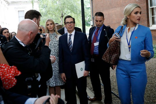 Secretary of Treasury Secretary Steve Mnuchin and Senior White House Advisor Ivanka Trump and others, wait to enter 10 Downing Street, Tuesday, June 4, 2019, in London.