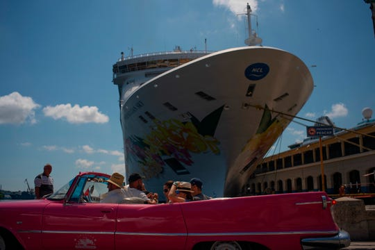 Tourists who have just disembarked from a cruise liner, tour the city aboard a vintage American convertible, in Havana, Cuba, Tuesday, June 4, 2019. The Trump administration has imposed major new travel restrictions on visits to Cuba by U.S. citizens, banning stops by cruise ships and ending a heavily used form of educational travel as it seeks to further isolate the communist government.