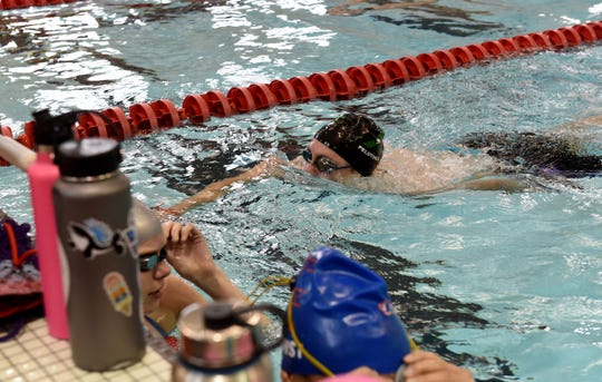 Pau Hana swimmer Austin Masters finishes a drill wearing one of the teams Pelotonia themed caps during a team practice on Wednesday, June 5 2019 at Denison University's Mitchell Recreation and Athletics Center. Pau Hana will host the annual Jill Griesse Memorial the weekend of June 14 at Denison.