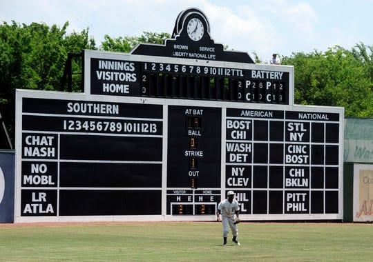 Birmingham Barons outfielder Luis Basabe moves toward a ball in front of the vintage scoreboard at Rickwood Field, America's oldest baseball park, during a Double-A game between the Barons and the Montgomery Biscuits on Wednesday, May 29, 2019, in Birmingham, Ala. Built in 1910, the ballpark predates better-known parks including Chicago's Wrigley Field and Fenway Park in Boston.