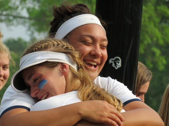 Senior Caylee English (right) hugged teammates, friends and family following Immaculate Conception's 6-1 loss to top-seeded Donovan Catholic in the semifinals of the third annual NJSIAA softball Tournament of Champions at Seton Hall University on Wednesday, June 5, 2019.
