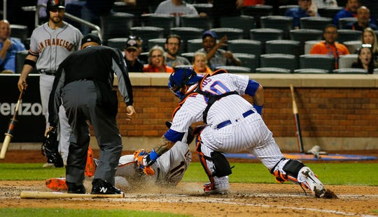 Jun 4, 2019; New York City, NY, USA; San Francisco Giants third baseman Evan Longoria (10) is tagged out at home by New York Mets catcher Wilson Ramos (40) trying to score during the seventh inning at Citi Field.