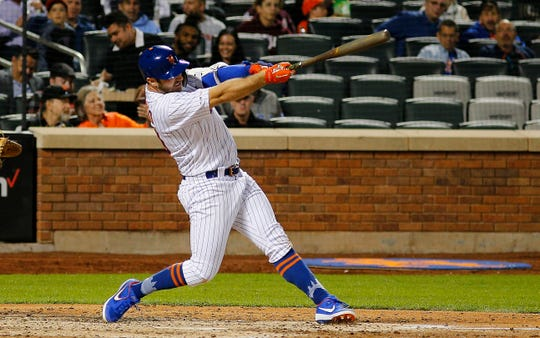 Jun 4, 2019; New York City, NY, USA; New York Mets first baseman Pete Alonso (20) hits a solo home run against the San Francisco Giants during the sixth inning at Citi Field.