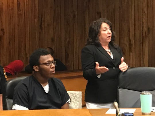 Najee Dean (L) with his attorney, Susan McCoy.