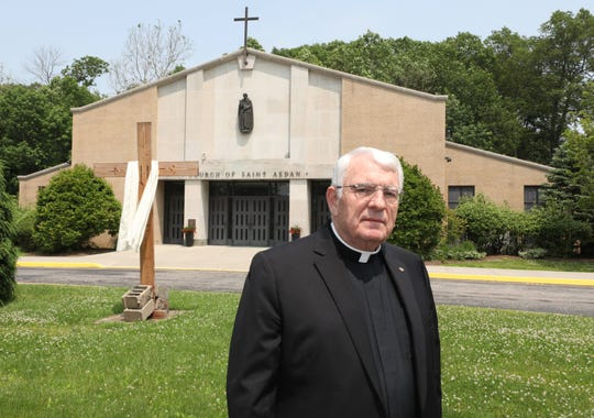 Rev. Msgr. Emmet R. Nevin, the pastor of St. Aedan Catholic Church in Pearl River, is pictured on the property, June 5, 2019.