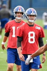 New York Giants quarterbacks Daniel Jones (8) and Eli Manning, left, stretch on Day 2 of Giants minicamp on Tuesday, June 4, 2019, in East Rutherford.