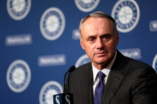 Rob Manfred, Commissioner of Baseball, addresses media members before a baseball game between the Seattle Mariners and Houston Astros Tuesday, June 4, 2019, in Seattle.