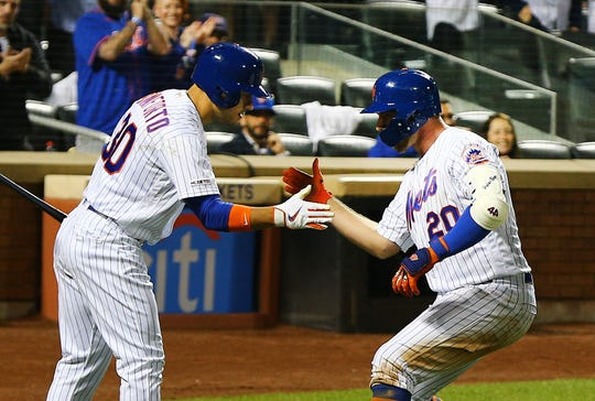 Jun 4, 2019; New York City, NY, USA; New York Mets first baseman Pete Alonso (20) is congratulated by right fielder Michael Conforto (30) after hitting a a solo home run against the San Francisco Giants during the sixth inning at Citi Field.