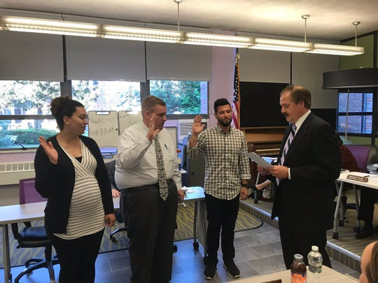 Ashley Adams, (left), Anthony Albro, and Jason Levine were all sworn onto the New Milford BOE on June 3.