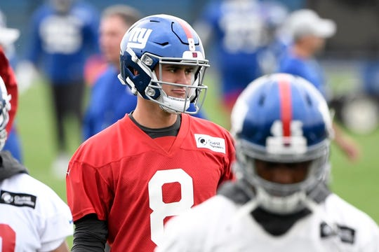 New York Giants rookie quarterback Daniel Jones stretches with the team on Day 2 of Giants minicamp on Tuesday, June 4, 2019, in East Rutherford.