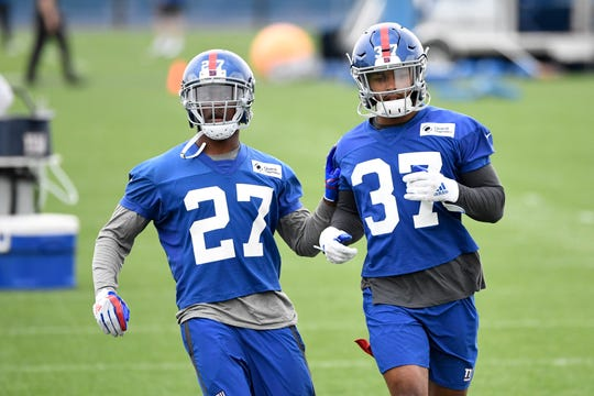 New York Giants rookie cornerbacks DeAndre Baker (27) and Julian Love (37) participate in drills on Day 2 of Giants minicamp on Tuesday, June 4, 2019, in East Rutherford.