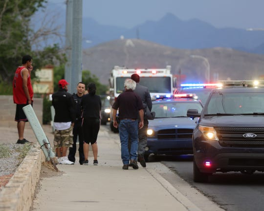 Las Cruces police officers talk with people about a reported outside of a home in the 400 block of East University Drive, just after 5 p.m. Tuesday June 4, 2019.