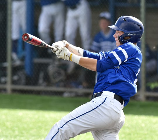 Catholic Central's Blake Solomon at bat.