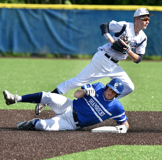 The Livonia Stevenson Spartans were upset that Shamrock Ryan Marra was called safe on this play at second after he slid through the bag and wiped out Spartan Jacob Townley, top.