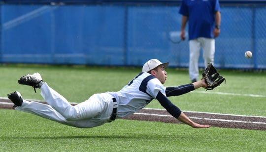 Spartan pitcher Nick Olsen made this diving snatch of an infield pop-up by CC's Dante Merucci in the first inning.