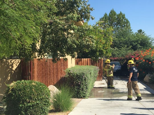 Cal Fire firefighters investigate a fire that occurred Wednesday at a home on Alessandro Drive in Palm Desert. Several occupants were displaced and one person suffered burns.