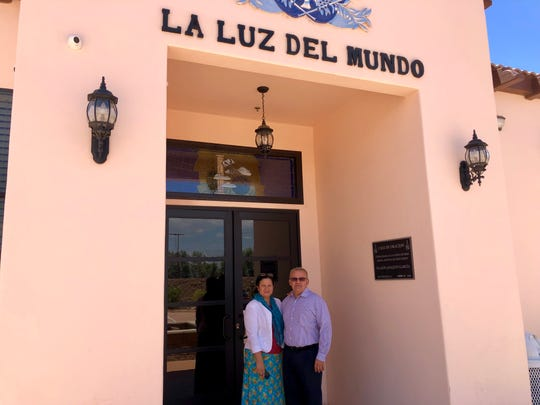Palm Springs pastor Azael Alonzo stands with his wife, Areli, outside of La Luz del Mundo church in Palm Springs