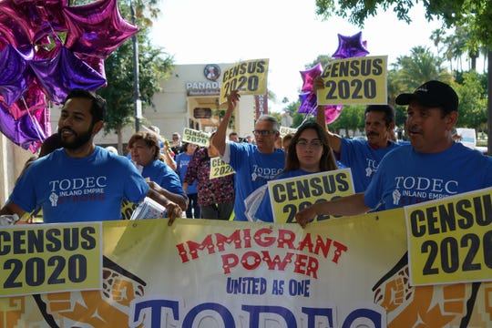TODEC workers and volunteers walk through downtown Coachella to inform people about the importance of participating in the census, Coachella, Calif., May 14, 2019.