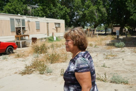 Griselda Garcia, the manager of Desert Rose Mobile Home Park, walks through the original part of the mobile home park, Thermal, Calif., May 15, 2019.