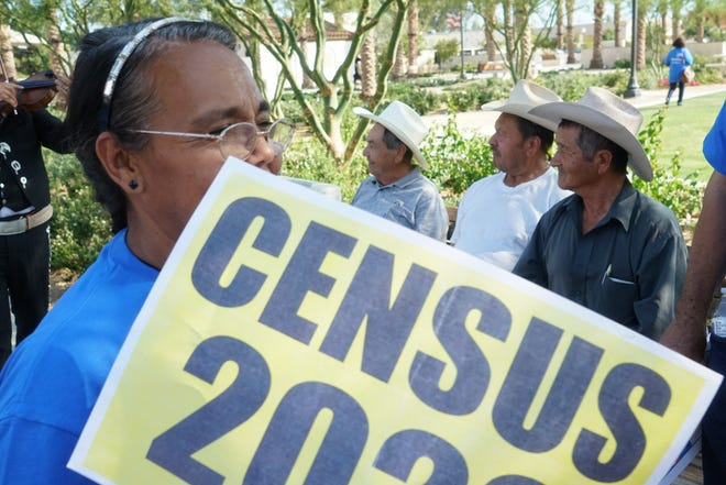TODEC workers and volunteers walk through Veterans Park in downtown Coachella to inform people about the importance of participating in the census, Coachella, Calif., May 14, 2019.