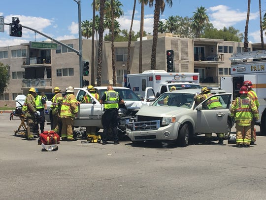Authorities respond to a collision at Tahquitz Canyon Way and Farrell Drive in Palm Springs Wednesday. It was one of two collisions to occur near each other in the afternoon.