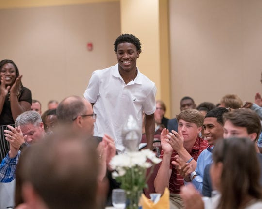 Pine Forest senior Devon Witherspoon smiles after winning PNJ Overall Boys Athlete of the Year at the 2019 PNJ All-Sports Awards Banquet at the Saenger Theatre in Pensacola on Tuesday, June 4, 2019.