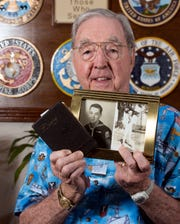 World War II veteran Charley Pritchett shows photos of himself from the war, as well as a diary of his service.