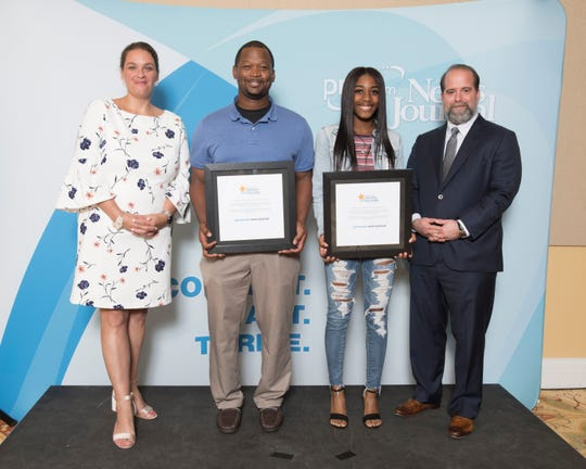 Pine Forest track coach Brian Fisher and junior Koriyunna Arrington accept awards with Pensacola News Journal executive editor Lisa Nellesseen-Savage (left) and attorney Troy Rafferty (right) at the 2019 PNJ All-Sports Awards Banquet at the Saenger Theatre in Pensacola on Tuesday, June 4, 2019.