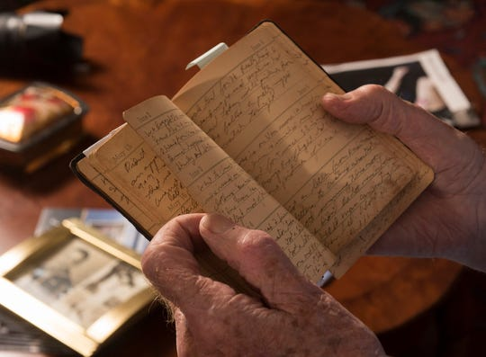 World War II veteran Charley Pritchett shares a passage from his wartime diary on Wednesday.