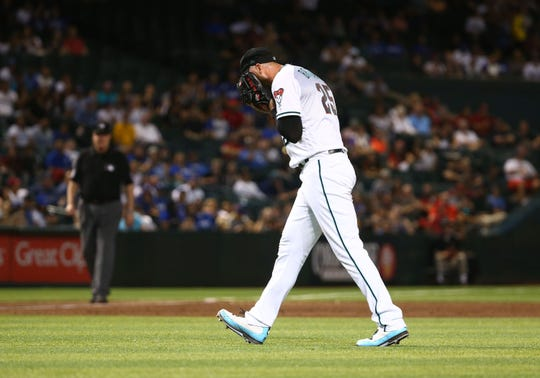 Arizona Diamondbacks pitcher Archie Bradley reacts onto his glove after allowing three run to be scored by the Los Angeles Dodgers in the ninth inning on June 4, 2019 at Chase Field in Phoenix, Ariz.