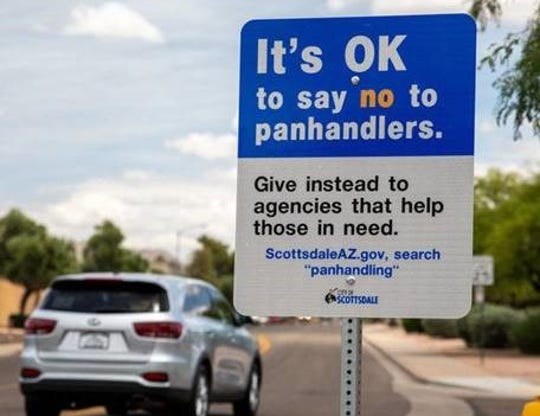 Scottsdale is placing temporary signs throughout the city to discourage residents from donating to panhandlers and instead donate to social service agencies.