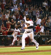 Eduardo Escobar scores the game-winning run against the Dodgers during the 11th inning of a game June 5 at Chase Field.