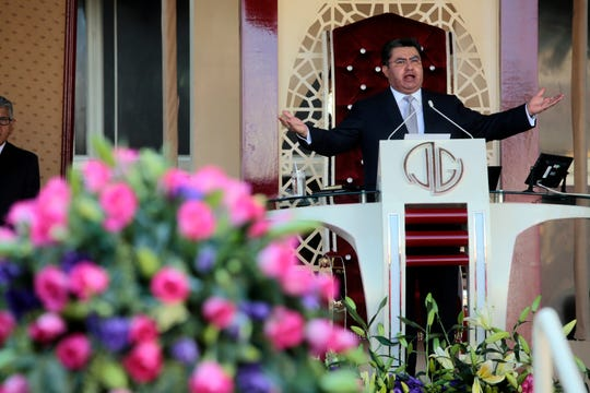 Naasón Joaquín García leads a service. He has been charged in Los Angeles with 26 felony counts, including child rape, trafficking and child pornography.