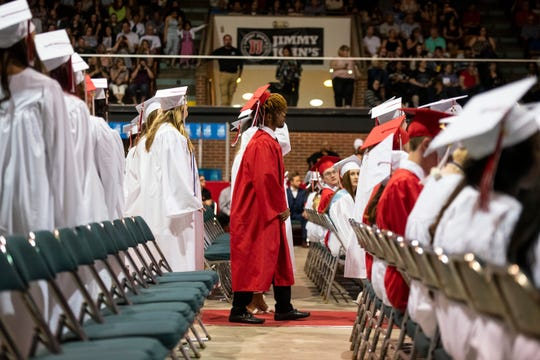 Graduating seniors from Port Huron High School line up to receive their diplomas during the school's 151st commencement ceremony Tuesday, June 4, 2019 at McMorran Arena.