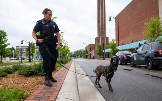 Port Huron Police Officer Jennifer Sly leads Jade, the department's 14-month-old explosive sniffing dog, into McMorran Arena for training Wednesday, June 5, 2019.