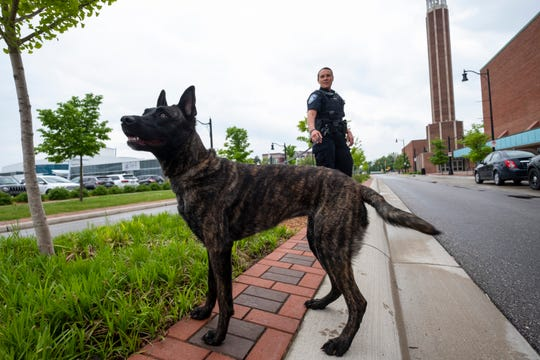 Port Huron Police Officer Jennifer Sly stands with Jade, the department's 14-month-old explosive sniffing dog, before a training exercise Wednesday, June 5, 2019 at McMorran Arena.