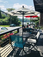 Views of the river and Walkway Over the Hudson can be seen from the deck at Nic L Inn in Poughkeepsie.