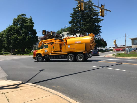 A municipal truck makes a left turn from East Market Street onto South Harrison Street. Many of the crashes involve this turning movement, and transportation officials are looking at a fix.