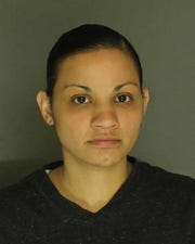 Haydee Corredor, arrested for endangering the welfare of children, simple assault and harassment.